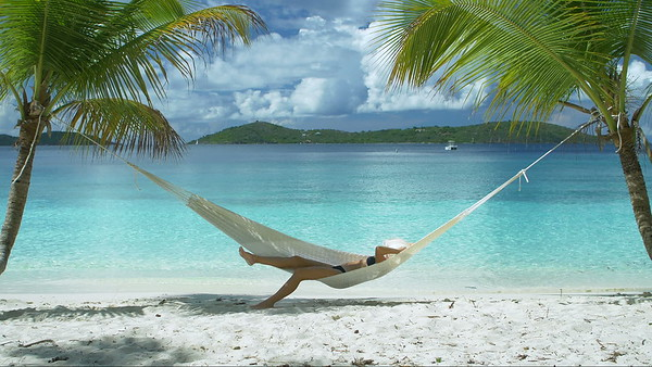 0033 video of a woman relaxing in hammock on perfect tropical beach