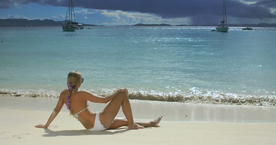 0019 woman sunbathing on tropical beach, White Bay, Jost Van Dyke