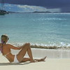 0019 woman sunbathing on tropical beach, White Bay, Jost Van Dyke