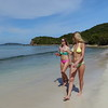 0061 slow motion video of women walking on a tropical beach, smuggler's cove, tortola