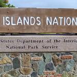 0089 woman walking by virgin islands national park sign, st john, united states virgin islands