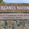 0089 woman walking by virgin islands national park sign, st john, united states virgin islands