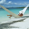 0024 slow motion video of a woman relaxing in hammock on perfect tropical beach