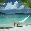 0025 video of a woman relaxing in hammock on perfect tropical beach