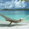 0028 video of a woman relaxing in hammock on perfect tropical beach