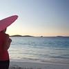 0087 woman walking with umbrella on tropical beach, St John