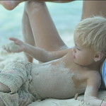 0029 mother and child relaxing and playing on the beach in St John, United States Virgin Islands