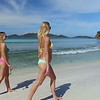 0059 slow motion video of women walking on a tropical beach, smuggler's cove, tortola
