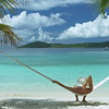0026 video of a woman relaxing in hammock on perfect tropical beach