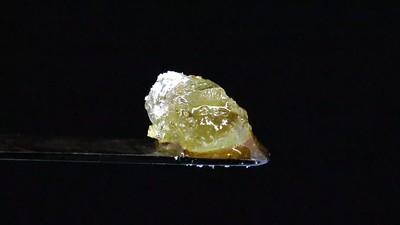 Melting Large Diamond & Sauce on Black Background