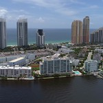Aerial video of Sunny Isles Beach condominiums and shopping plazas