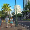 Tourists walking on Kalakaua Avenue Waikiki Beach