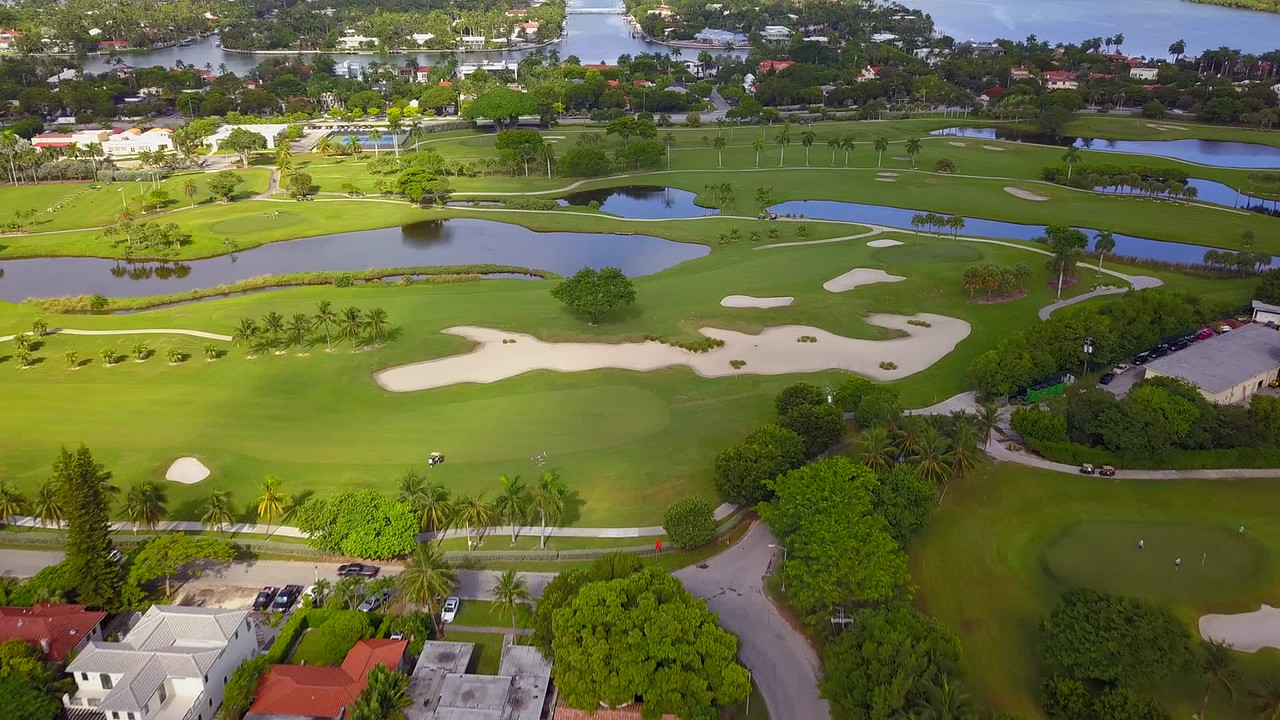 Aerial Miami Beach golf scene and houses Bayshore