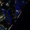Miami Beach aerial drone video highrise building blue lights night 4k