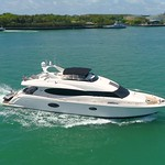 Aerial slow motion orbit of a luxury yacht
