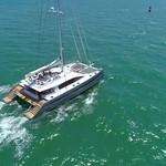 Slow motion drone aerial follow catamaran boat ocean