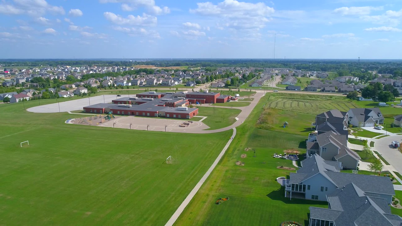 Stock aerial video residential neighborhood and a school