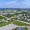 Aerial ascent over a residential neighborhood