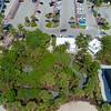 Aerial tilt up reveal Miami Beach mansions 4k 24p