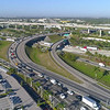 Aerial drone video morning commute highway interchange