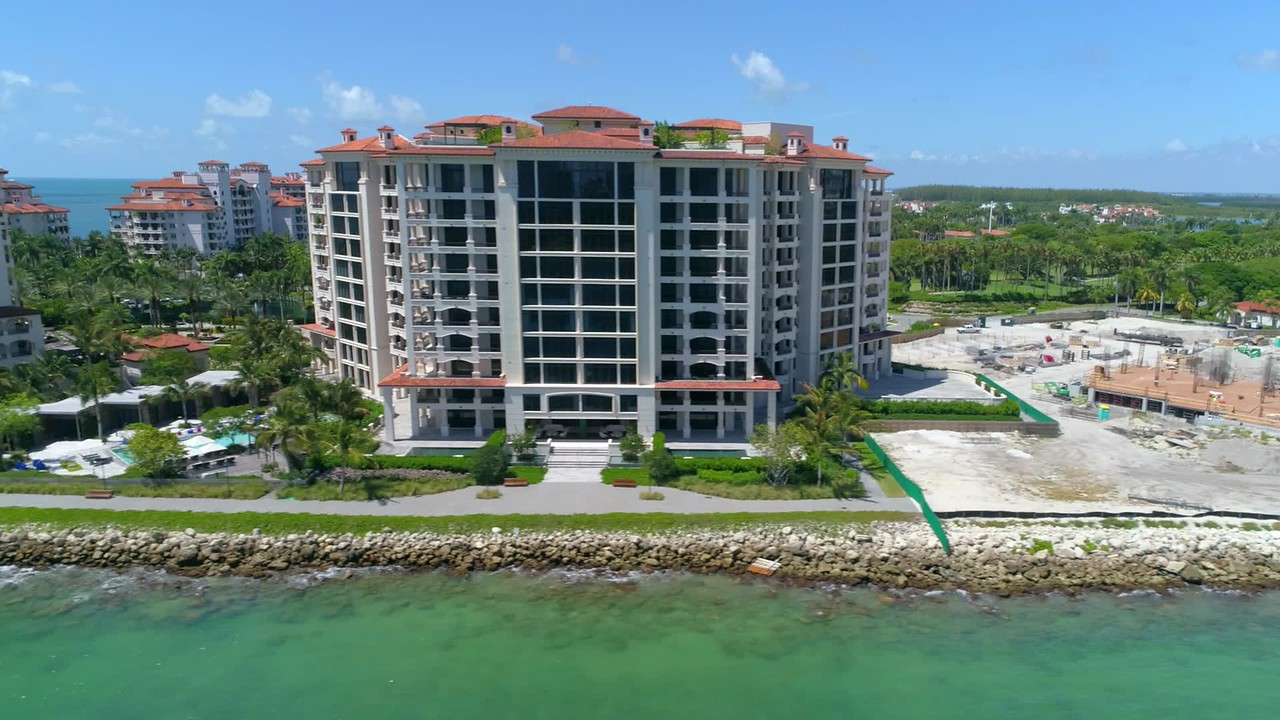Aerial helicopter flyby Fisher Island Miami Beach 4k 60p