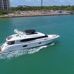 Slow motion drone aerial follow luxury yacht Miami Beach