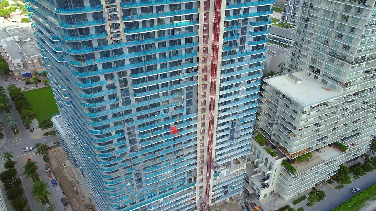 Dron rising over a building under construction