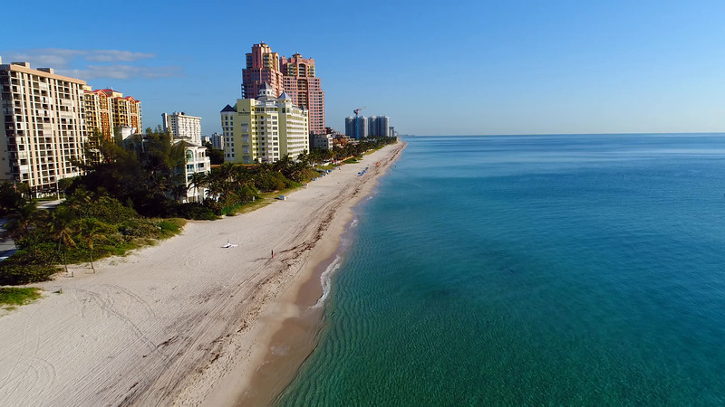 Aerial video Pelican Grand Beach Resort and The Palms