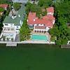 Sideways drone footage over luxury Miami Beach homes 4k 24p