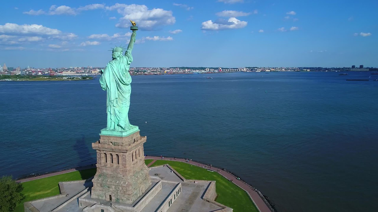 Aerial drone video Statue of Liberty flyby reveal New York City 4k 60p