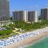 Aerial hyperlapse flyby beachfront buildings Miami