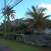 Hawaii homes and volcanic mountains