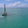 Aerial video tourists on a catamaran and sup 4k 60p