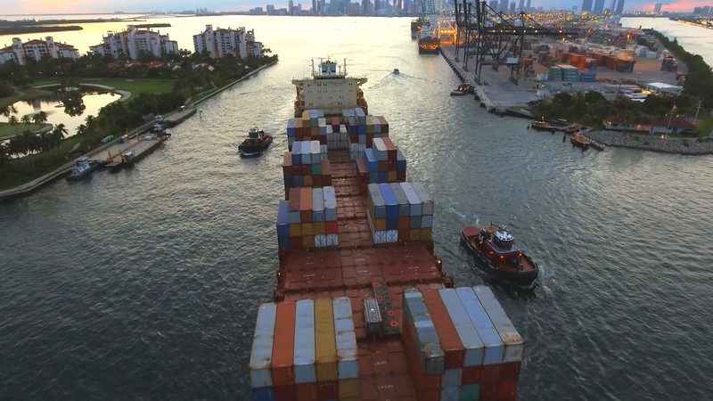 Aerial footage Cargo container ship leaving Port Miami 4k