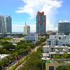 Aerial approach establishing shot Miami Beach highrise condominiums