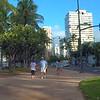 Stock video Tourists walking on Kalakaua Avenue Waikiki Beach