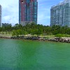 Miami Beach South Pointe Park shore rocks palm trees 4k 60p