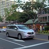 Crossing Kalakaua Avenue Waikiki Honolulu Hawaii