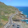 Cars driving along the Kalanianaole Highway Oahu HAwaii