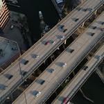 Cargo ship under a highway
