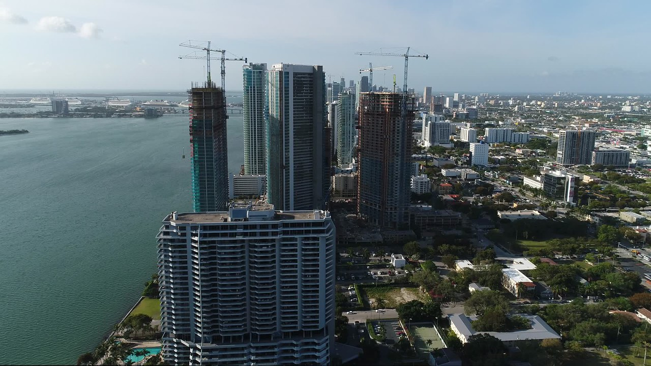 Aerial video of multiple buildings under construction