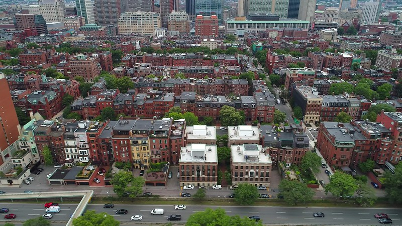 Sideways aerial flight Boston Back Bay neighborhood 4k