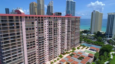Aerial video Sunny Isles Beach highrise with hurricane shutters