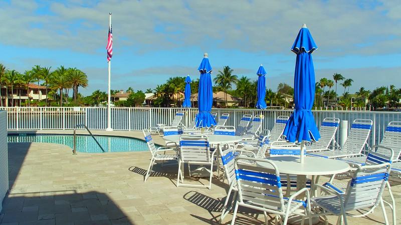Swimming pool with lounge furniture