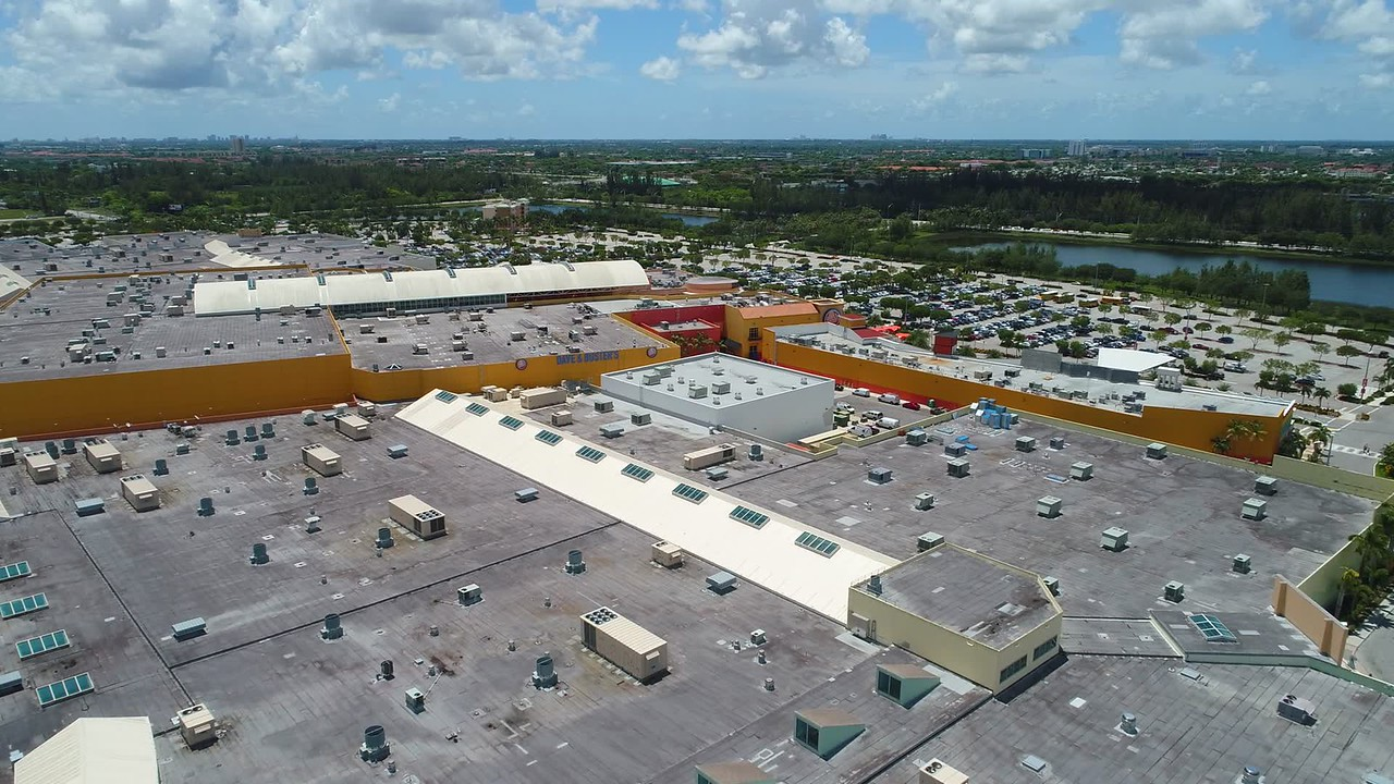 Aerial drone video Dolphin Mall Miami rooftop flyover