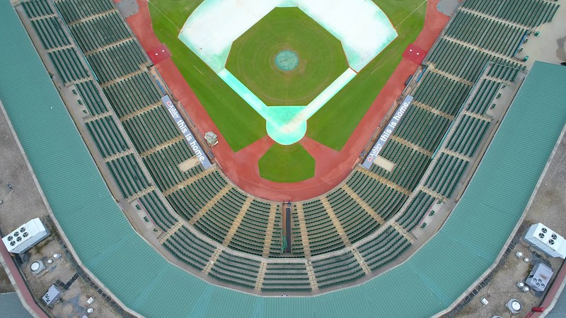 Aerial tilt up Louisville Slugger Stadium to reveal Downtown and the Ohio River