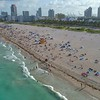 People on Miami Beach aerial video 4k 60p