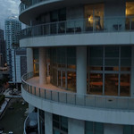 Aerial drone flying up the side of a building Downtown Miami 4k 24p