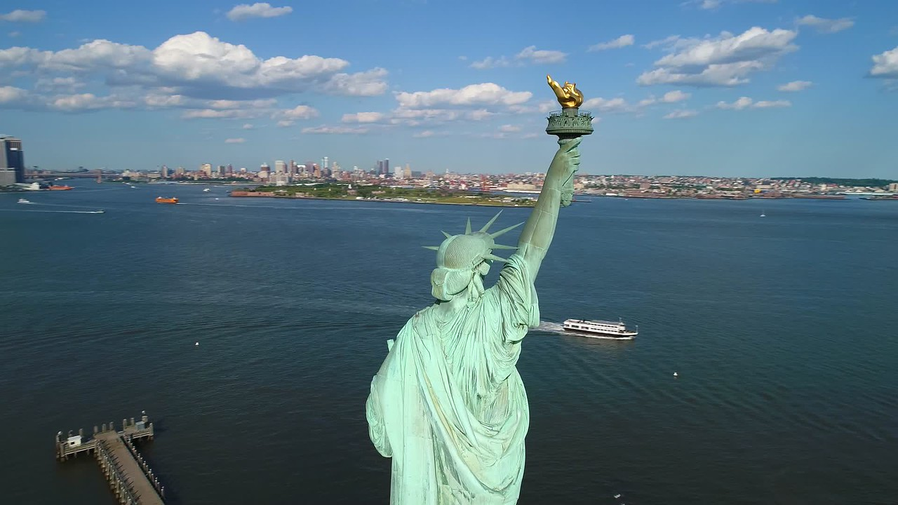 Drone orbiting around the Statue of Liberty 4k 60p