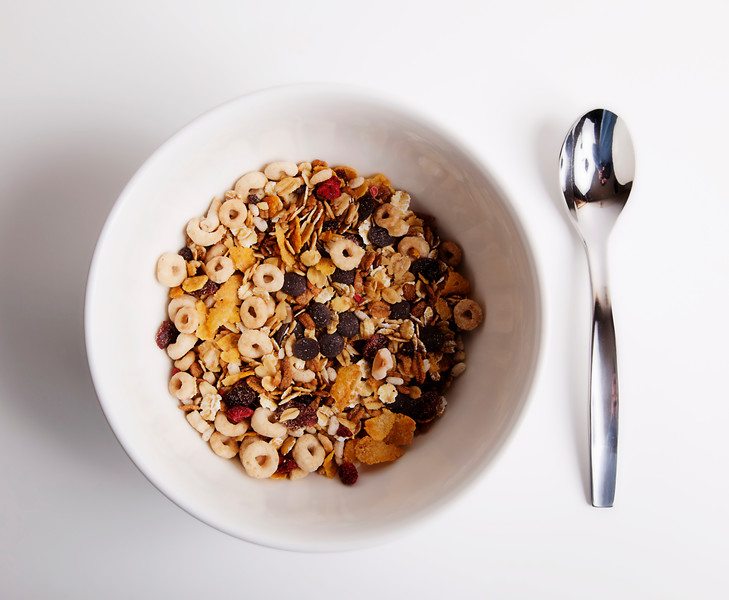 white bowl of cereal and spoon for the brealfast